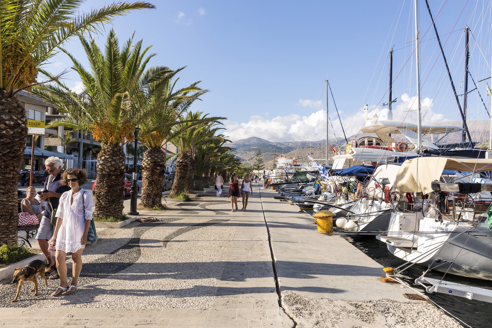 People stroll along the promenade of Argostoli.